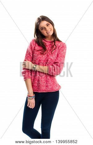 Woman in pink pullover smiling. Watch and bright-colored bracelets. Brand new woolen sweater. Apparel for stylish youth.