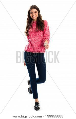 Woman in pink sweatshirt smiling. Dark pants and shoes. Trends of autumn fashion. Stylish wear for youth.