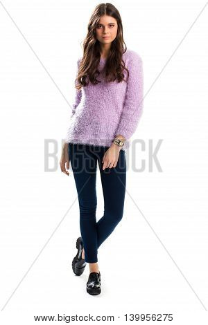 Woman in light purple sweater. Black shoes and navy trousers. Fluffy and soft pullover. Spring wear from boutique.