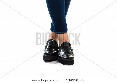 Woman's legs in black footwear. Dark navy pants and shoes. Trendy shoes from new store. Leather slip ons.