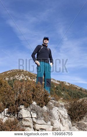 Mountaineer Looking The Landscape On A Rock