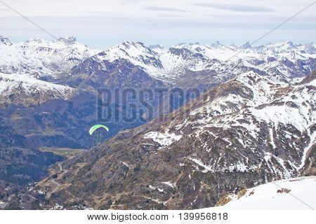 Parachute flying over a snow mountain chain