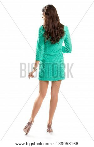 Woman in short turquoise dress. Watch and beige heel shoes. Stylish and elegant look. Bright spring dress.