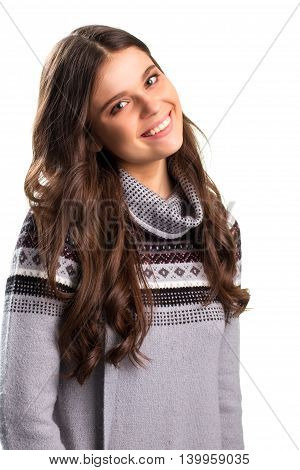 Smiling lady on white background. Young woman in gray sweatshirt. Peaceful and romantic smile. Honesty and kindness.