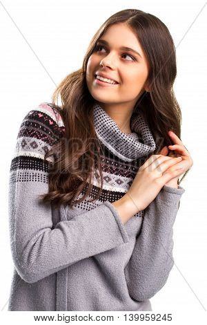 Girl in gray pullover smiling. Happy face of young woman. Anticipation of holiday. Soul filled with joy.