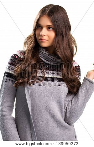 Lady looks to the side. Woman in patterned sweater. Calm and confident look. Don't lose composure.