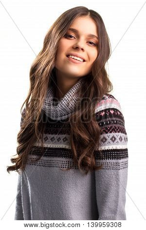 Girl in pullover is smiling. Pretty face of young lady. Person overfilled with pride. Sweet sense of power.
