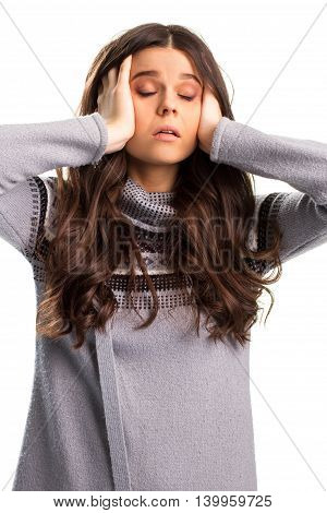 Lady holds head with hands. Gray sweater with high collar. Serious problems at work. Things can't get any worse.