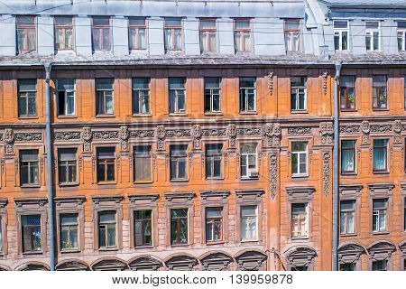 The windows of the old house on Pushkin Street in St. Petersburg.