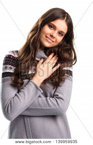 Girl holds hand on chest. Lady in sweater is smiling. What a relief. Be calm and happy.