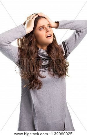 Woman holding head with hands. Girl on white background. Anxious and nervous state. Afraid to lose everything.