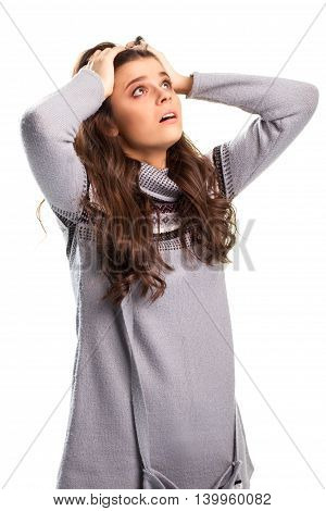 Girl holds head with hands. Black pattern on gray pullover. It's an absolute failure. We lost it all.