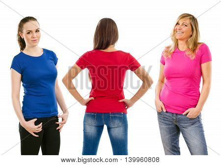 Photo of three women posing with blue red and pink blank t-shirts ready for your artwork or design.