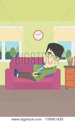 An asian young man lying on a sofa and watching tv with a remote control in his hand. Vector flat design illustration. Vertical layout.