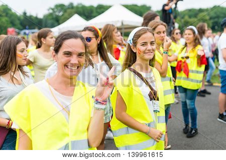Poznan POLAND - JULY 24 2016: pilgrims spending time together during Days In Dioceses just before The World Youth Day in Krakow; WYD is an international meeting of youth from all over the world