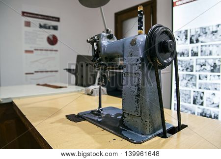 Close up of sewing machine for the manufacture of gloves