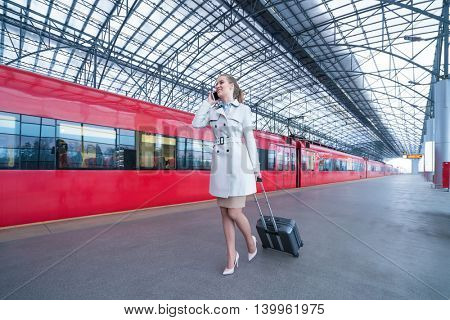 Traveling beautiful woman at the station