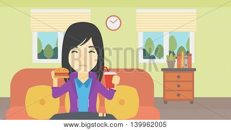 An asian young woman sitting on a sofa while eating hamburger and drinking soda on the background of living room. Vector flat design illustration. Horizontal layout.