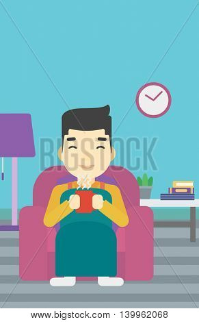 An asian young man relaxing under blanket with cup of coffee. Man drinking coffee at home. Man holding cup of hot flavored coffee. Coffee lover. Vector flat design illustration. Vertical layout.