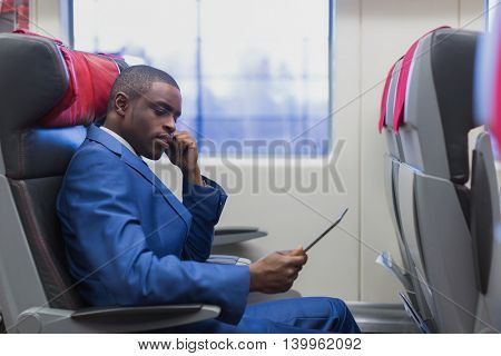 Young businessman in a train