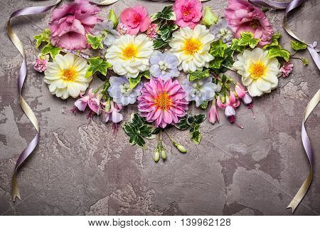 Festive flower composition with ribbon.Overhead view