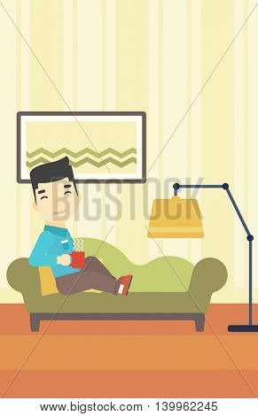 An asian young man lying on sofa in living room and holding a cup of hot flavored tea. Vector flat design illustration. Vertical layout.
