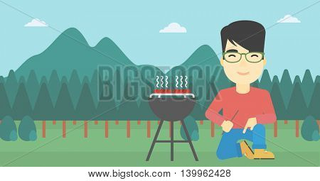 An asian man sitting next to barbecue grill in the park. Man cooking meat on the barbecue grill. Man having a barbecue party. Vector flat design illustration. Horizontal layout.