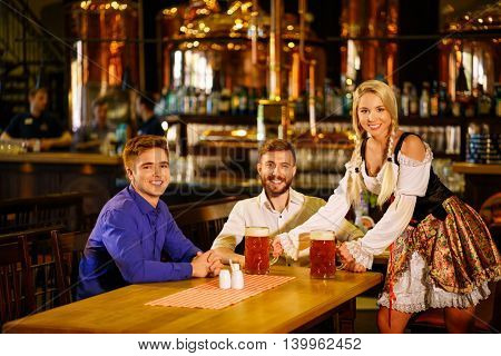 Smiling people in a bar