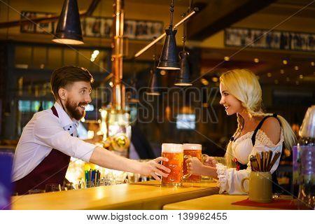 Bartender and waitress at the pub