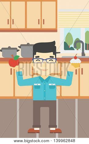 An asian man standing with apple and cupcake in hands in the kitchen. Man choosing between apple and cupcake. Dieting concept. Vector flat design illustration. Vertical layout.