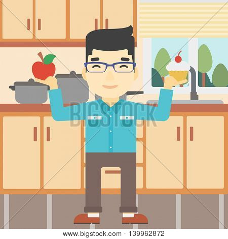 An asian man standing with apple and cupcake in hands in the kitchen. Man choosing between apple and cupcake. Dieting concept. Vector flat design illustration. Square layout.
