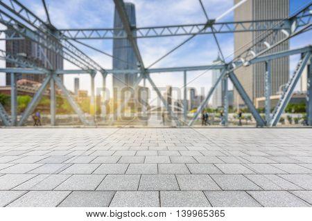 steel bridge and modern skyscrapers against sunbeam,tianjin china.
