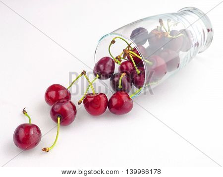 Fresh Cherries on White Table with Tumbler