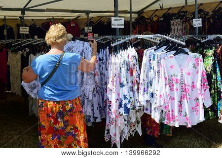 TENDRING SHOW ESSEX 11 JULY 2015: Dressses for sale on outdoor stall