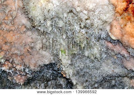 Bellamar caves (Cuevas de Bellamar) Cuba. Underground geological landmark with different types of stalactites and stalagmites. Close up photo of salt stone wall.