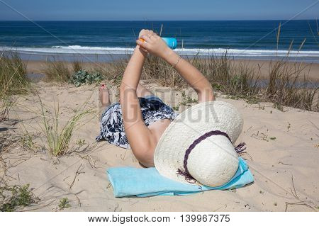 Sunscreen Woman Showing Suntan Lotion Bottle Applying Solar Cream To Arm