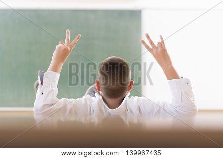 Teen boy in classroom