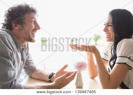 Happy couple interacting with each other in cafeteria