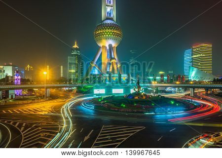 light trails at downtown district,shanghai china.