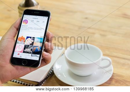 CHIANG MAI THAILAND - JUN 232016: A man holds Apple iPhone with Instagram application on the screen. Instagram is a photo-sharing app for smartphones.