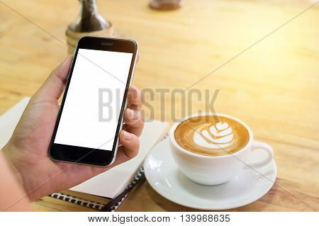 A man holds smart phone with blank screen