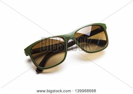 Green and modern Sunglasses. Isolated on white background