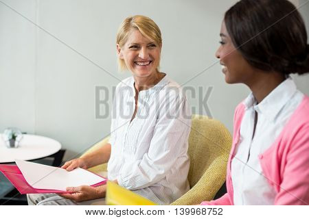 Woman interacting with her colleague in the office