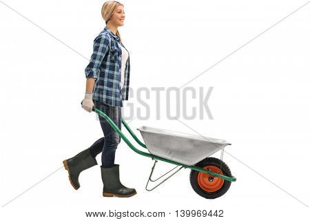 Female worker pushing an empty wheelbarrow isolated on white background