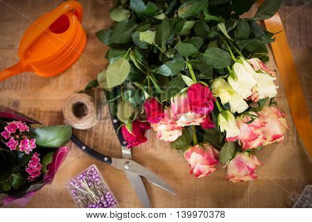 Close-up of bouquet of flower material on a wooden worktop