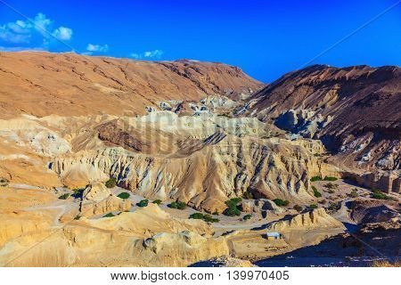 Ancient mountains in the valley of the Dead Sea. Picturesque multicolored sandstone dry talus