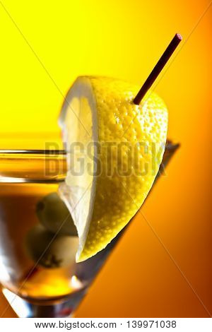 Martini With Lemon And Green Olives