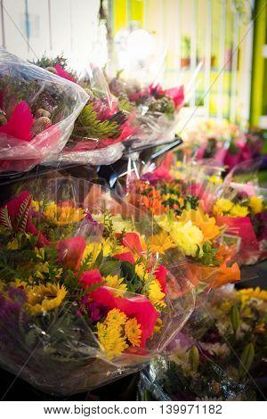 Bouquet of flower arranged on a flower shelf at flower shop