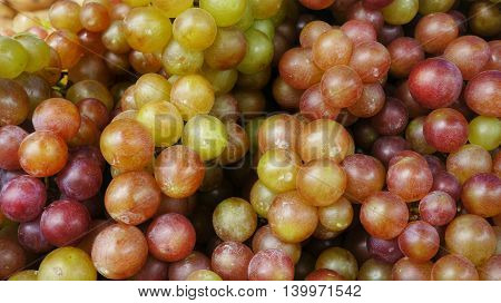 Red grapes lying in a bunch looking very natural