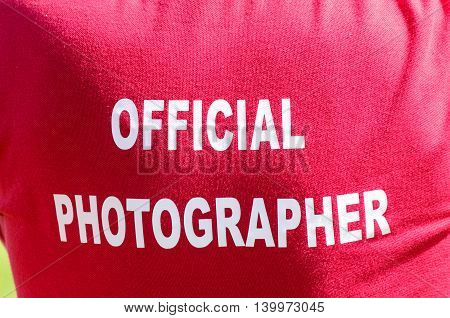 Photographer with the wording official photographer on his T-shirt UK
